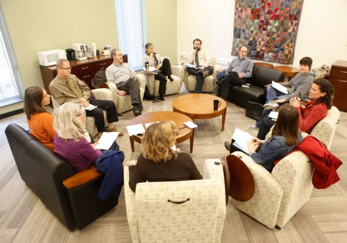Professors discussing together during a learning circle.